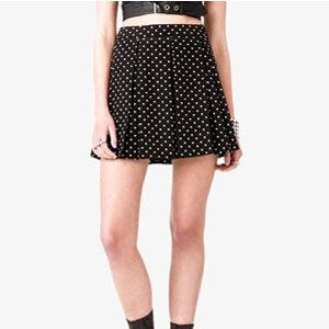 <p>A-line skirts are very figure-flattering. Make sure you tuck in your top though, otherwise you will do the opposite and look bigger. Polka dots are fun and flirty for spring.</p>