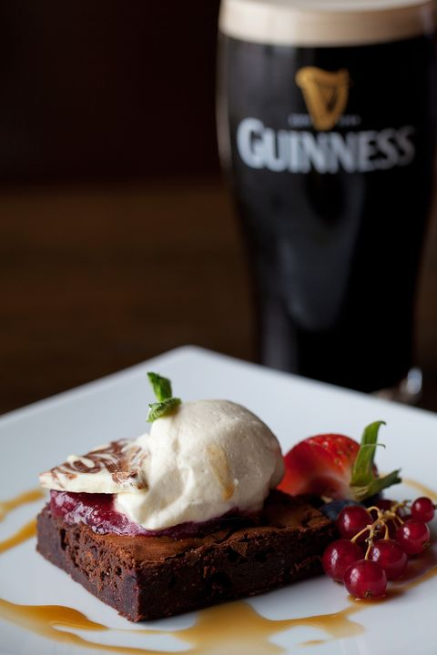 <p><strong>Ingredients Serves 12</strong></p> <p><strong>Serves 12</strong></p> <p><strong>Ingredients</strong></p> <p>1⁄2 cup Guinness</p> <p>6 1⁄2 oz dark Chocolate</p> <p>1 3⁄4 oz Milk Chocolate</p> <p>13 tbsp Butter</p> <p>3 Eggs</p> <p>1 1⁄4 cup Caster Sugar</p> <p>Vanilla Essence</p> <p>1/3 cup Plain Flour</p> <p>1 1⁄2 tbsp coco powder</p> <p>1⁄4 cup White Chocolate buttons</p> <p><strong>Method</strong></p> <p>1.Line a baking tray with parchment paper and sprinkle white chocolate buttons in tray.</p> <p>2.Melt the Guinness, butter, dark and milk Chocolate together, remove from heat when melted.</p> <p>3.Whip eggs sugar and vanilla essence (until figure of 8) and fold into the chocolate mix.</p> <p>4.Sieve in flour and coco powder, folding in 3 stages. 5.Pour into tray and spread out bake for 20 – 22 minutes at 320° F. 6.Serve warm with Vanilla ice cream.</p>