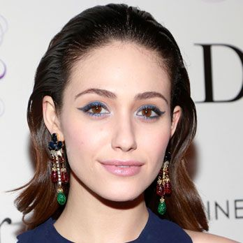 The gorgeous actress worked a hotter-than-hot new look at the <i>Beautiful Creatures</i> premiere: purple cat eye shadow, sleek hair, and a pale pink pout.