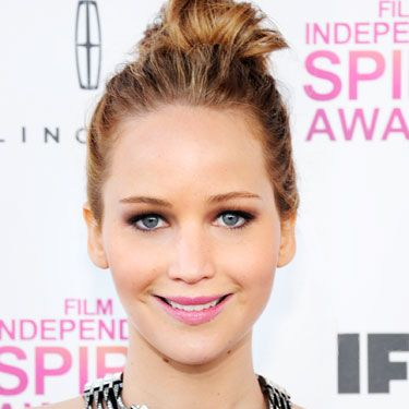 Lawrence was princessy-pretty at the Oscars, but her Independent Spirit Awards look was hot. We love the haphazard topknot, the smear of fuschia lip gloss, and the saucy smile.