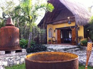 <p>If you're touring the Mayan ruins in Tulum, make your experience even more authentic by trying out some Mayan cuisine. This little restaurant is adorable and very inexpensive (not more than $20 an entree). The queso relleno and dulce de papaya are to die for, and you won't be dissapointed when you try the aguas frescas!</p>