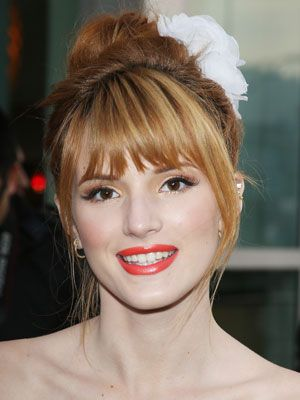 <p>This is a very versatile face shape, so any kind of bangs look good: short, long, or side swept are all great options. We love Bella Thorne's choppy bangs. <br /><br /></p>
