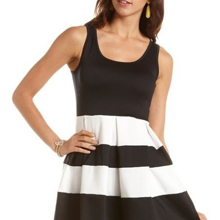 """<p>How many times have we told you black and white is a huge trend? This is a must-have.</p><p> </p><p>$28.99, <a href=""""http://www.charlotterusse.com/product/Dresses/entity/dc/999999/sc/3021/232753.uts"""" target=""""_blank"""">Charlotte Russe</a></p>"""