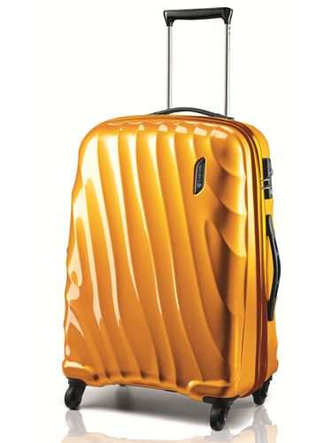 """As the perfect carry on, this light case easily rolls and spins with you wherever you go.<br /><br />  Carlton Travel Goods  Dune, $150, <a href=""""http://www.sears.com/carlton-travel-goods-dune-19inch-polycarbonate-spinner-trolley/p-SPM7433378410?prdNo=4&blockNo=4&blockType=G4"""" target=""""_blank"""">sears.com</a>"""