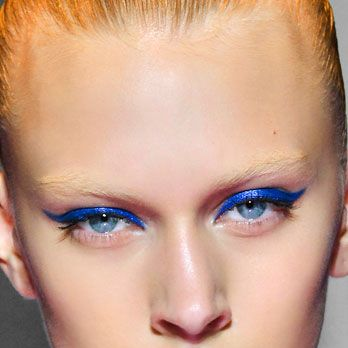 Dusk Blue (like L'Oréal's hue, below) may have been one of Pantone's top-10 colors for spring, but nearly every shade of blue was present on the runways... and in dozens of different ways. We're partial to peacock blue ombré lids (at Monique Lhuillier), a cobalt cat eye (at Versus), and midnight smoke (at Jeremy Scott).