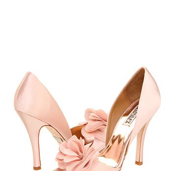 <p>Make a statement with these elegant pumps and a tres chic flower accent.</p>