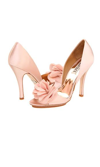 "<p>Make a statement with these elegant pumps and a tres chic flower accent.</p> <p>Badgley Mischka Randall heels, $200, <a href=""http://www.zappos.com/badgley-mischka-randall-pink-satin"" target=""_blank"">zappos.com</a></p>"