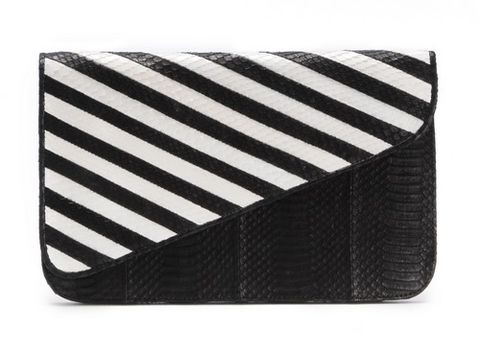"<p>If you are a big <em>SATC </em>an you know the fabulous Carrie Bradshaw wore one of Adriana Castro's bags in the <em>Sex and the City 2</em>, so obvi all her <em>bolsas</em> are fab. We're loving this black and white clutch.</p> <p> </p> <p>$995, <a href=""%20https://adrianacastroonline.com/collection.php?collection_in=Spring%20/%20Summer%2013"" target=""_blank"">Adriana Castro</a></p> <p> </p>"