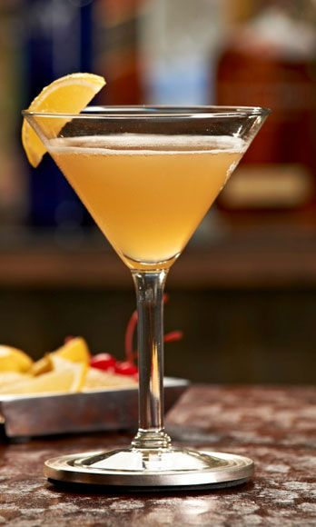 """<i>2 oz. gin1½oz. sweet & sour1 oz. honey syrup</i><br /><br />To make honey syrup, mix equal parts hot water, sugar, and honey until sugar is dissolved. Combine all ingredients in a cocktail shaker filled with ice. Shake vigorously and strain into a glass.<br /><br /><i>Source: <a href=""""http://www.hardrock.com/"""" target=""""_blank"""">Hard Rock Cafe</a></i>"""