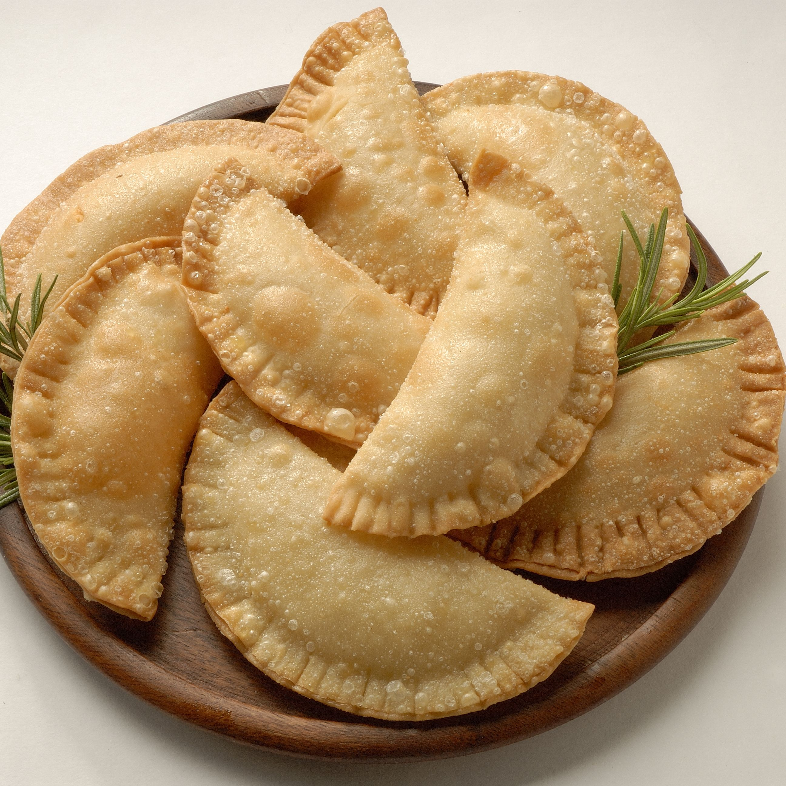 <p>8 oz. package of cream cheese spread<br />8 oz. package of guava paste<br />10 prepared empanada dough discs<br />Oil for frying<br /><br /></p>