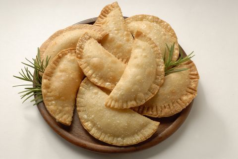 <p>8 oz. package of cream cheese spread<br />8 oz. package of guava paste<br />10 prepared empanada dough discs<br />Oil for frying<br /><br /></p> <p>Lay one prepared dough disc onto a lightly floured counter top.<br />Place one tablespoon of cream cheese and one tablespoon of guava paste on the circle of dough. Keep it centered; do not go all the way to the edge.<br />Fold the dough over into a a half circle shape and crimp the edges with a fork. If the edges won't stay sealed you can dip the fork in water before crimping or use an egg wash.<br />Fry the filled empanadas at 360 degrees for 1 to 2 minutes per side. They should be lightly golden. Drain on paper towels.<br /><br /></p> <p><em>Source: About.com</em><br /><br /></p>
