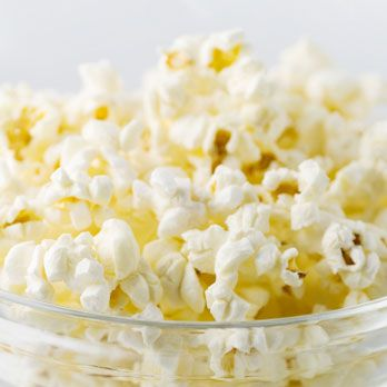 "<p>Skip the buttery calorie bomb, and opt for a <a href=""http://www.cosmopolitan.com/advice/health/sneaky-ways-to-eat-healthy"" target=""_blank"">fresher, healthier version</a>. Pop 2 tablespoons of kernels, then drizzle with 1 teaspoon extra-virgin olive oil and 1/2 teaspoon sea salt. Mix well to coat. <br /><br /> 170 calories</p>"