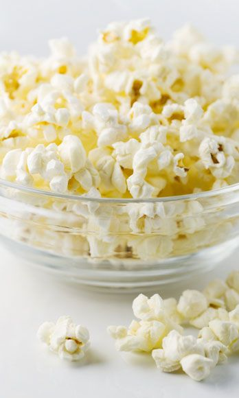 """<p>Skip the buttery calorie bomb, and opt for a <a href=""""http://www.cosmopolitan.com/advice/health/sneaky-ways-to-eat-healthy"""" target=""""_blank"""">fresher, healthier version</a>. Pop 2 tablespoons of kernels, then drizzle with 1 teaspoon extra-virgin olive oil and 1/2 teaspoon sea salt. Mix well to coat. <br /><br /> 170 calories</p>"""