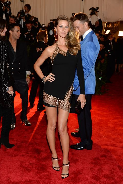 <p>Who says galas are for long gowns only? Gisele dazzled in a one-sleeve LBD with chain cutouts.</p>