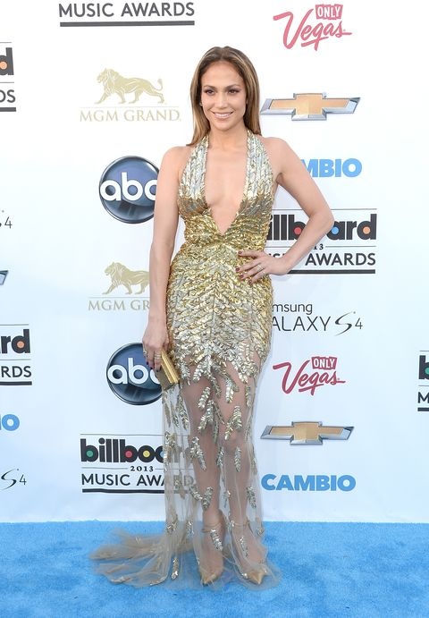 <p>When doesn't JLo look glamorous? The gold goes perfect with her skintone. She worked the trend with mesh at the bottom of her dress. </p>