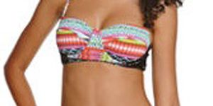 """<p>If you've got junk in the trunk finding a bottom that is flattering can be a little tough. Go for a bikini bottom with side detailing, such as a tie, bow, or ruched. An all-over pattern will also help to distract the eye and downplay your bottom.</p> <p>$34.95, <a title=""""Pacsun"""" href=""""http://www.pacsun.com/Desi-Tropic-Tab-Side-Bottom/0811134250012,default,pd.html?dwvar_0811134250012_color=001&start=36&cgid=womens-swimwear%20"""" target=""""_blank"""">Pacsun</a></p>"""