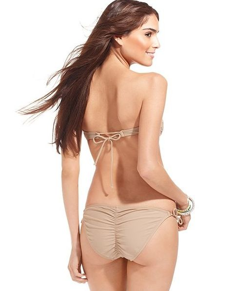 """<p>Not everyone has that J Lo bootie but that's nothing a few squats and the right bottom can't fix. Try going for a bottom that's ruched, it will give your butt a more round appearance.</p> <p>$44, <a title=""""Bar iii bottom"""" href=""""http://www1.macys.com/shop/product/bar-iii-swimsuit-solid-side-tie-ruched-back-brief-bottom?ID=832530&cm_mmc=Google_Womens_PLA-_-Womens+PLA+FS_Ad+Group+%232-_-20464699478_-_-_mkwid_Z5ne2VKz_20464699478%7C-%7CZ5ne2VKz"""" target=""""_blank"""">Macy's</a></p>"""