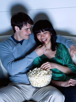 <p>Skip the typical Friday movie night and dig out old <em>peliculas</em> you both love. You won't risk picking a mushy, chick flick or a total guy movie if you choose your faves together. </p>