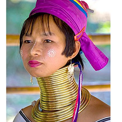 "<p>Women of the Kayan tribe in Thailand start <a href=""http://www.oprah.com/style/Beauty-Around-the-World/5#ixzz2VHVgNYDK"" target=""_blank"">wearing brass rings</a> around their necks when they're just five years old, adding more rings as they grow older to elongate their necks. A super-long neck is considered beautiful and elegant in this region and women can wear over 20 pounds of rings as adults.</p>"