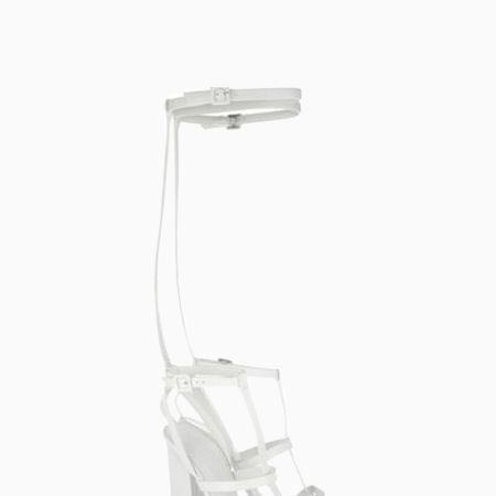 <p>These white Choies OTK sandals sandals have the perfect amount of edge, with a low chunky heel.</p>
