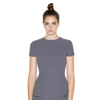 <p>For those times you need a little sophistication for your look, this peplum dress is great. The color allows for lots of accessories and the short sleeves will protect your shoulders from the sun!</p>