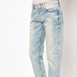 <p>Because cuffing jeans can sometimes make an already petite figure look shorter and wider, you want to go for a pair that's slightly tapered at the hem to make you look longer and leaner. Try to avoid anything too wide at the bottom, and a good tailor is always a short girl's BFF.</p>