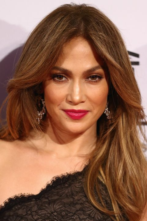 """<p class=""""normal"""">The key to this look is all in the cut. Next time you're at the salon ask for longer layers (or """"wings"""") to be cut in the front to frame your face. You can get the beachy look one of two ways: with heat, grab a ½ inch barrel iron or curling wand and wrap medium sections of hair around it for a few seconds and then pin each section up to hold the curl. Curl the sections closest to the face away from your face, and for a really sexy look, vary the size of sections and direction you curl the rest of your hair. Without heat, set slightly damp hair on flexirods and allow to air dry. Fluff the hair out with your fingers and add a little holding spray (we love <a href=""""http://www.moroccanoil.com/usa/h_us_en/luminous-hairspray-190""""><span style=""""color: #1155cc;"""">Moroccanoil Luminous Hairspray</span></a> for providing touchable hold).</p>"""