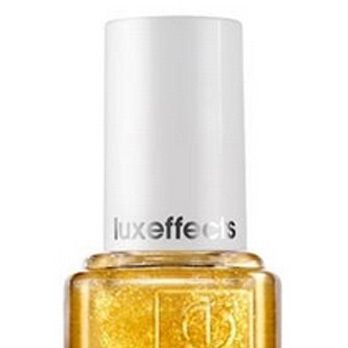 <p>This sheer top coat is infused with golden sparkles! Layer it on top of your favorite nail color for a dose of glitzy-fab razzmatazz (did we spell that correctly?).</p>