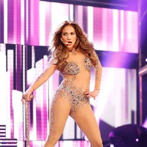 <p>What can be more tempting to the eye than a nude skin-tight body suit. JLo definitely had jaws dropping at the 2011 American Music Awards.</p>