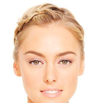 In circular motions, dust bronzer all over your face and neck to set base, then apply a second layer to your cheekbones, nose, temples, and chin. Tap coral blush onto the apples of your cheeks, apply beige shadow to lids, and trace the upper lash line with a gray pencil.