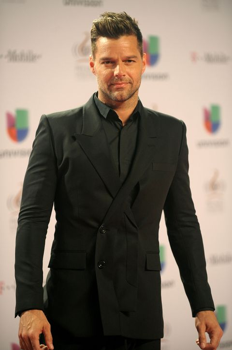 """<p>The Puerto Rican-born superstar started his career in the teen boy band Menudo, but it wasn't long before he became a worldwide sensation with hits such as <em>Living La Vida Loca</em> and <em>She Bangs</em>. While Martin kept his sexuality under wraps for a while, he came out as a proud gay man in 2010. """"I am proud to say that I am a fortunate homosexual man. I am very blessed to be who I am."""" He can now be seen all over town with his boyfriend Carlos Gonzalez and their two adorable sons Matteo and Valentino. <br /><br /></p>"""