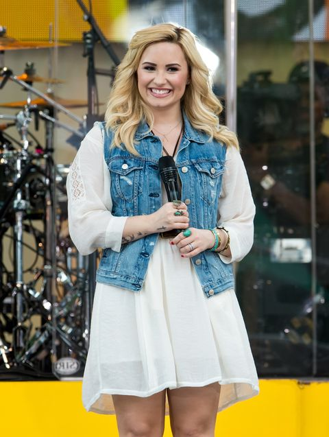 <p>Demi was on trend with a denim jacket over her cute summer dress.</p>