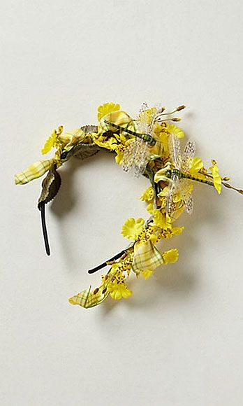 "<p>How could he not notice you, with a cluster of irresistibly cheery, bright yellow flowers strewn throughout your hair? So radiantly pretty.</p> <p>Bees Knees Fascinator, $148, <a href=""http://www.anthropologie.com/anthro/product/accessories-hair/28657799.jsp"" target=""_blank"">anthropologie.com</a></p>"