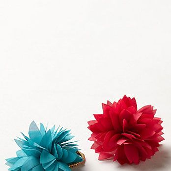 <p>Feeling like an entire garland of flowers might be too much? Fasten your pony or bun in a floral tie – it sends the same flirty, feminine message.</p>