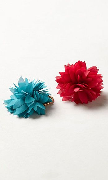 "<p>Feeling like an entire garland of flowers might be too much? Fasten your pony or bun in a floral tie – it sends the same flirty, feminine message.</p> <p>Fluttering Dahlia Hair Ties, $12, <a href=""http://www.anthropologie.com/anthro/product/accessories-hair/28497436.jsp"" target=""_blank"">anthropologie.com</a></p>"