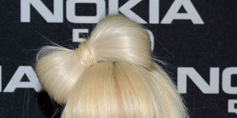 """<p>The 'do that started it all. Back in the """"Poker Face"""" era, Gaga set the club world on fire with this cheeky hair bow. RuPaul's Drag Race has yet to get over it.</p>"""
