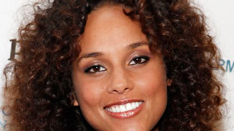 <p>For tighter curls, have your stylist cut blunt along the bottom if your hair is longer, with a few shorter layers placed throughout the hair and around the face. For medium length or shorter hair, ask for layers all around like Alicia Keys.</p>