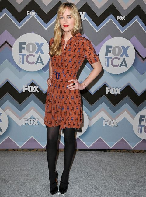 <p>So cute! At the TCA Winter Press Tour, Johnson paired a flirty, belted shift with black tights and scarlet lips.</p>