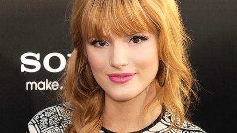 <p>Starlet Bella Thorne looks beyond romantic in this thick, ropy plait with bangs. Leave loose, face-framing tendrils for an extra dose of hotness.</p>