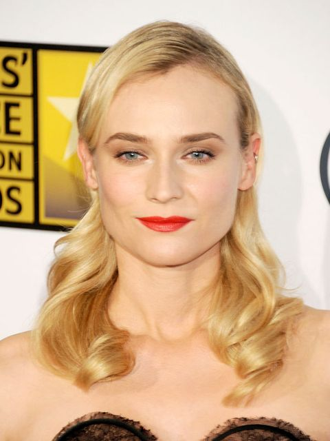 <p>Go all-the-way sultry with a 1950's-style a'la Diane Kruger. To do: create a deep side part, tuck hair behind your ears, and wind ends around a jumbo curling iron.</p>