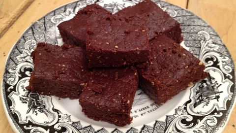 <p><strong>No Bake Brownie</strong></p> <p>This recipe is so easy and delicious you are going to freak out! The brownies take all of 10 minutes (way faster than baking!) and still give you that rich, sweet, gooey flavor—but since they're naturally sweetened with dates, they won't eff with your blood sugar. The raw cacao is full of nutrients like magnesium and iron, which you need when you're surfing the crimson wave. I recommend making a big batch when Aunt Flo comes to town and freezing the leftovers for next month.</p> <p>• 1 cup raw walnuts <br />• ½ cup raw almonds<br />• 1.5 cups Medjool dates, pitted (the fresher the better)<br />• 1 cup raw cacao powder<br />• 1 teaspoon alcohol free vanilla extract<br />• ¼ cup almond butter (or unsalted peanut butter)<br />• ½ teaspoon sea salt</p> <p><strong>Directions</strong><br />Place walnuts and almonds in food processor and blend on high until the nuts are finely ground. Add the cacao, vanilla and salt. Pulse to combine. Pit and chop the dates then add them one at a time through the feed tube of the food processor while it is running. After dates are combined add the nut butter. What you should end up with is a mix that appears rather like cake crumbs, but that when pressed, will easily stick together (if the mixture does not hold together well, add more dates). Press the mixture into a brownie pan, Tupperware container. Place in freezer of fridge until ready to serve (it is also easier to cut these when they are cold). Store in an airtight container.</p>