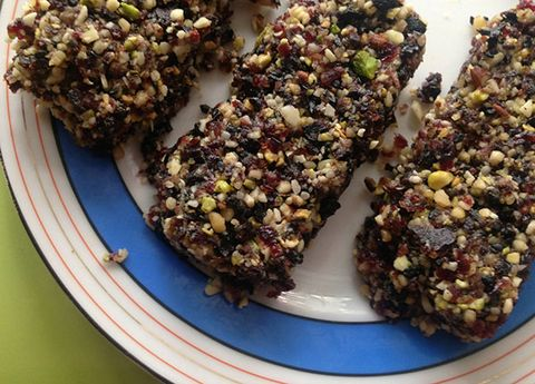 <p><strong>Fruit & Nut Energy Bars</strong></p> <p>Make a batch of bars at the beginning of the week and you'll be set with a snack wherever you go (and you'll avoid all the gross preservatives that you find in packaged products). The beauty of this recipe is that you can mix and match your favorite fruits and nuts to create a totally personalized power bar. The natural sugars in the honey and fruits give you instant energy and the protein from the nuts and seeds sustains you. Just remember that a healthy portion is about the size of two fingers.</p> <p>• 1 cup raw or roasted nuts (almonds, cashews and peanuts or a combination!)<br />• 2 tablespoons sesame seeds or hemp seeds<br />• 1 cup dried fruit. I suggest a mixture of cranberries, raisins, and cherries<br />• 2 tablespoons honey</p> <p>You could also add in spices like cinnamon, nutmeg, cardamom, chili powder…or anything else that sounds yummy and interesting.</p> <p><strong>Directions</strong><br />Grind nuts, fruit and seeds in a food processor until fairly fine but still having some texture—you don't want it to get creamy. Add honey and pulse long enough for it to blend in. Firmly press the mixture into a square container with lid, cover and refrigerate for an hour or more.</p>