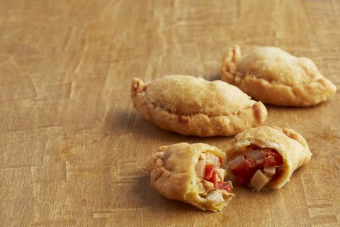 <p>Try this recipe featured in the current issue of CFL! Chef Aaron Sanchez shares his recipe to making some amazing chicken empanadas. </p> <p><strong>Ingredients</strong></p> <p>3 cups flour</p> <p>1 tsp salt</p> <p>10 tbsp unsalted butter</p> <p>6 tbsp sortening</p> <p>1 egg</p> <p>1/2 cup beer</p> <p>1 small onion, cut into 1/2 inch dice</p> <p>2 plum tomatoes, cut into 1/2 inch dice</p> <p>1 14 ounce can hearts of palm, drained and cut into 1/2 inch dice</p> <p>2 tbsp butter</p> <p>1/2 pound cooked shredded chicken</p> <p>1 egg yolk</p> <p>Salt and freshly ground pepper</p> <p>Oil, for frying</p> <p><strong>Preparation</strong></p> <p>Sift together the flour and salt. Work in the butter and shortening until it has a cornmeal-like consistency. Add egg and beer, and work until incorporated. Cover with a wet towel, and rest for 15 minutes</p> <p>Meanwhile, saute the onion, tomatoes, and hearts of palm in butter for 2 to 3 minutes, until soft. Deglaze with sherry. add tomato paste and cook for 1 minute. Add chicken and cook for 2 minutes. Season with salt and pepper and cool.</p> <p>Preheat oil to 350 degrees.</p> <p>Roll dough into 1-inch balls and flatten into rounds approximately 3 inches in diameter. Scoop 1 tablespoon of stuffing onto each round, fold the dough in half, brush edges with egg yolk, and pinch to seal. Fry the empanadas for 4 minutes. </p> <p> </p>