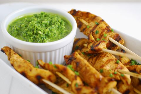 <p>Who doesn't love food on a stick? These chicken skewers are sure to be a hit. Chef Alejandra Ramos featured this delicious recipe in our Spring 2013 issue. The <em>chimichurri</em> sauce is an amazing extra kick to a simple dish. </p> <p><strong>Ingredients</strong></p> <p>For the sauce</p> <p>1/2 bunch fresh parsley, stems removed</p> <p>1/2 bunch fresh cilantro, stems removed</p> <p>4 garlic cloves</p> <p>1/2 cup olive oil</p> <p>1/2 cup red wine vinegar</p> <p>1 teaspoon kosher salt</p> <p>For the chicken</p> <p>1 pound chicken tenders</p> <p>3 tablespoons olive oil</p> <p>1 teaspoon kosher salt</p> <p>1 teaspoon ground black pepper</p> <p>1 teaspoon ground cumin</p> <p>Juice of 2 limes</p> <p>Wooden skewers</p> <p><strong>Preparation</strong></p> <p>Make the sauce: combine all ingredients in a blender or food processor and process until coarsely chopped. Set aside.</p> <p>Cut chicken tenders in half and toss in a bowl with olive oil, salt, black pepper, cumin, and lime juice. Heat a grill pan or skillet, and cook chicken 3-4 minutes on each side until cooked through and slightly charred. Once fully cooked, thread chicken onto skewers and serve with sauce on the side for dipping. </p>