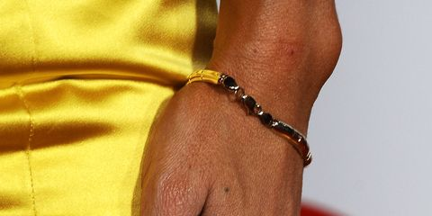<p>Because when you're rocking a bright yellow dress, a bright yellow flower rink and weirdly long polka dot nails, you've got add some rhinestone <em>flores </em>in there too for that extra affect your outfit was missing, right?</p>