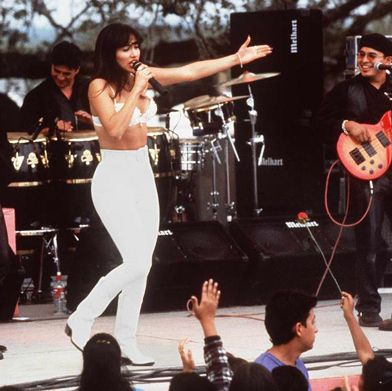 """<p><em>""""Dad! It's a bustier!""""</em> ... Dad screams, <em>""""It's a bra!"""" </em>(Best movie ever, btw). </p><p>Call it what you want, but Selena's bustier with leggings look is def back in style. I just rocked a crop top with black leggings myself this weekend. It's the perfect club night look, and every Latina has rocked the ensemble at least once. </p>"""