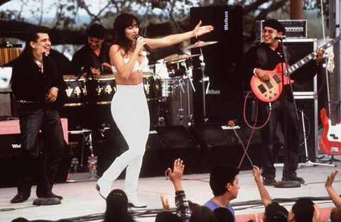 """<p><em>""""Dad! It's a bustier!""""</em> ... Dad screams, <em>""""It's a bra!"""" </em>(Best movie ever, btw). </p> <p>Call it what you want, but Selena's bustier with leggings look is def back in style. I just rocked a crop top with black leggings myself this weekend. It's the perfect club night look, and every Latina has rocked the ensemble at least once. </p>"""