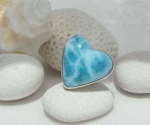 """<p>Larimar aka Stefita's Stone is found only in la Republica. The stone varies from white to variations of blue. Get yourself a great statement piece.</p> <p>$119, <a title=""""larimar"""" href=""""http://www.etsy.com/listing/162325569/larimar-heart-ring-sea-love-and-mermaid?ref=shop_home_feat%20%20"""" target=""""_blank"""">LarimarAndSilver</a>.</p>"""