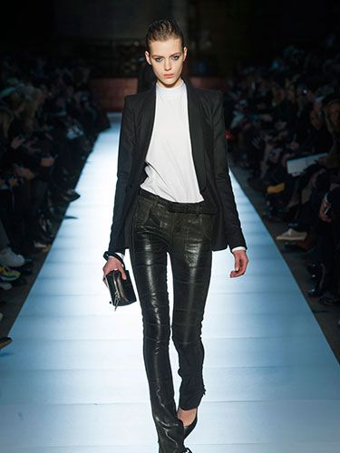 Leather-look cigarette pants give the classic tuxedo jacket a sexy, avant-garde edge.