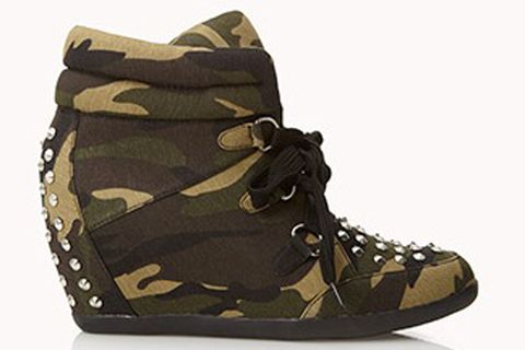 "<p>High-Voltage Camo Wedge Sneakers</p> <p>Get military inspired with your shoe swag. These give you the camo feel but also add studs and an ankle cuff for an extra edge.</p> <p>$39.80, <a title=""Forever 21"" href=""http://www.forever21.com/Product/Product.aspx?BR=f21&Category=shoes_sneakers&ProductID=2054218441&VariantID=%20"" target=""_blank"">Forever 21.</a></p>"